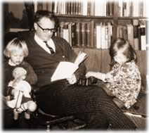 Reading with his daughters